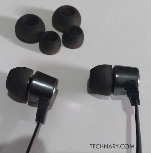 "Evidson had recently <a href=""http://www.technary.com/gadgets/evidson-audiowear-r5-launched-for-rs-999/"">launched the </a>Evidson Audiowear R5 headphones. We got an opportunity to use these earphones. We like to use earphones for enjoying music and also to do handsfree calling. Well, both are a utility and you will be amazed to know that these earphones do have a mic to give you that handsfree utility while calling through your smartphone.   <h2>Evidson Audiowear R5</h2> <h3>Design</h3> The first thing which we observe in the design of these earphones is the flat cable. The cable does seem to be durable. So you can enjoy these earphones for a long time. The biggest problem of earphones in long run is the cable tearing out or getting malfunction when you tangle. Well these earphones will solve the problem as these earphones are having a strong and durable cable.   These earphones are stylish and light weight. The metal alloy of the in-ear looks fantastic. Even the grill of the earphones inside the earpiece looks nice. These earphones are designed specifically for people who like simplicity with premium look. Though these may look simple in design but these are made to fit into your ears perfectly and stay in there for long time. So you can enjoy long time usage of these earphones without any problems.   There are hybrid silicon earbuds provided with these earphones. These are in sizes like small, medium and large according to the requirement of the user. They are mostly useful for the comfort level and also to reduce noise level of the surroundings. These are very useful for an enjoyable experience. These Evidson earphones come with a 3 button remote button control with mic. These are having buttons like Play/Pause, Prev & Next buttons. Also to pick up the calls you can receive them using the button. So there is convenience factor coming from these button control with mic.   <h3>Performance</h3> Before testing the earphones what I liked is the length of the flat cable. The length is 1.2m. So the length of the cable is sufficient to keep your smartphone inside your pocket and enjoy hands-free calling. I enjoyed music for a long time on the Evidson Audiowear R5. We played various songs of different genres. The bass quality was good and there was a clear sound quality from the earphones. The bass is not intense but it is subtle and it suits according to the music. So it is mainly made for you to enjoy music for a long time. This seems to be a great practice for the company as many people travel like me, I like to enjoy music for a long time during flights.   The sound quality was clear. The vocals of the songs were clear. So there is no such distortion as such even on high volume levels. Though we suggest our readers that not too go to the highest volume levels while listening to music as it may hamper your ears. So as a safety always keep less volume but not max for sure. The sound quality was good as per the price concerned of this device.   <h2>Final Verdict</h2> If you want good earphones just below Rs.1k then you should go for the value for money earphones, Evidson Audiowear R5 should be your choice."
